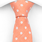 Linen necktie Ojin has white polka dots on light orange plain weave